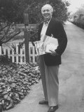 Actor Walter Brennan Standing in Front of His Home with Mail