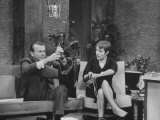 Jack Paar Clowning with French Singer Genevieve During His TV Program