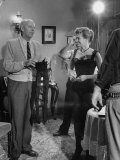 "Director Howard Hawks with Actress Angie Dickinson Between Scenes on Set for ""Rio Bravo"""