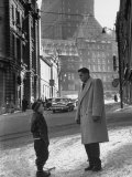 Ice Hockey Player Jean Beliveau  Standing in a Snow Covered Street Speaking to a Child