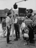 "Actor Clint Walker Standing with His Stand-In Clyde Howdy on the Set of ""Cheyenne"""