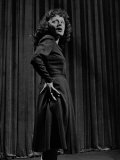 Singer Edith Piaf with Hands on Hips  Standing on Stage