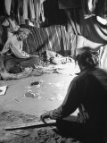 Native American Indian Men in Home Making Sand Drawings
