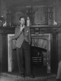 Actor Leslie Howard Smoking Pipe as He Stands by His Fireplace  at Home in Dorking  England