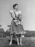 Actress Joan Crawford Hugging Her Adopted Daughter  While Wearing Identical Outfits
