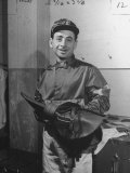 Jockey Johnny Longden Smiling and Holding Saddle