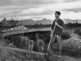 Architect Paolo Soleri Standing Outside His Underground  Concrete House