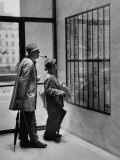French Actor Jacques Tati Looking at the Names of a Building