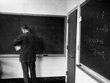 J Robert Oppenheimer  Working Out Physics Formulas on Blackboards