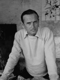 Artist Graham Sutherland Standing in His Home in the South of France  with His Work Behind Him