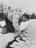 Astronaut Virgil I Grissom Using Roof Cement at Home