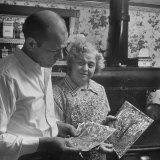 Painter Jackson Pollock Looking at Drawings with Woman