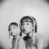Actress Shirley Maclaine and Daughter Sachi Parker Pouting with String of Pearls on their Heads