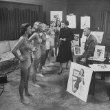 Terrestrial Esther Williams  Looking over Model's of the Year's Cole of California Bathing Suits