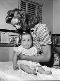 Actress Rita Hayworth  Brushing Her Baby's Hair