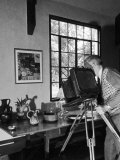 Artist Charles Sheeler Photographing a Still Life Scene to Be Painted Later