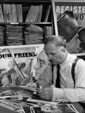 Artist Ben Shahn Looking Through Photos in Picture Collection of the New York Public Library