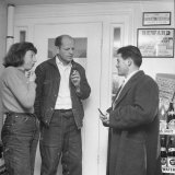 Painter Jackson Pollock and Lee Krasner Talking with Guest
