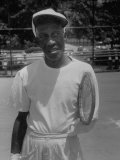 Althea Gibson&#39;s Tennis Instructor  Fred Johnson Holding Tennis Racket by Arm Stump  at Public Court