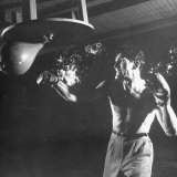 Actor Jack Palance in Boxing Trunks and Gloves  Hitting Punching Bag