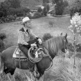 Actor Gene Autry Astride His Horse Championn Surveying His Ranch