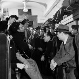 Folk Singer Woody Guthrie Playing His Guitar for Commuters on a Subway Train