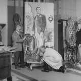 "Artists Malvin Albright and Ivan Albright  Working on their Portrait of ""Dorian Gray"""