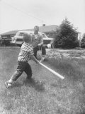 Mickey Mantle's Son Batting at Ball Pitched by Him