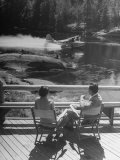 William Holden and His Wife Brenda Sitting on the Floating Dock  Admiring the Boat Planes