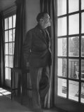 Author Somerset Maugham Gazing Out French Window onto Patio  at Home