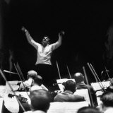 Composer Leonard Bernstein  While Conducting Musicians