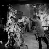 Actor Vincent Price Putting Out Fire in Film &quot;House of Wax&quot;