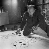 Painter Jackson Pollock Smoking as He Squats on Floor Applying Paint to Canvas  Long Island Studio
