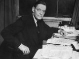 Writer T S Eliot Working at His Desk