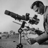 Life Photographer Ralph Crane Using a Bushnell Spacemaster Lens Attachment to Take Telephotos
