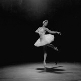 Ballerina Margot Fonteyn in White Costume Balanced on One Toe While Dancing Alone on Stage