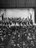 Maestro Arturo Toscanini Facing Standing Audience as He Conducts NY Philharmonic at Carnegie Hall