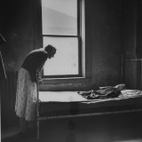 Old Woman Bent over the Foot of an Iron Bed in a Poorhouse