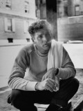 Actor Burt Lancaster  While Smoking Cigarette in Courtyard of Union Settlement House in E Harlem