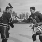 The Usa Team Giving the Swiss a Sweater and a Friendly Handshake before the Game