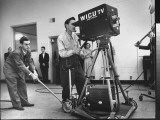 Cameraman Nick Luppino Honing in TV Camera During 1st Broadcast at Newly Opened WICV-TV Station