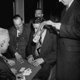 Commuter Arma Andon  Playing Cards with Other Train Commuters