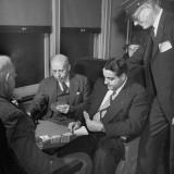 Commuter Arma Andon  Playing Cards with a Group of Men on the Train