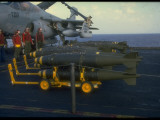 Loading Bombs onto US Navy A-6 Intruder Plane on Board Aircraft Carrier  in Mediterranean Sea