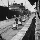 Tin Ingots Being Stacked Along the Penang Docks