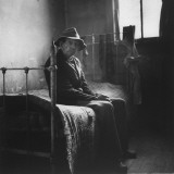 Old Man Sitting Patiently on Old Iron Bed as He Waits for Mealtime at Poorhouse in Perry County