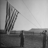 Children Raising the Flag Outside of a One-Room Country School
