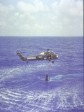 Project Mercury Freedom 7 Capsule and Astronaut Alan Shepard Are Lifted Out of Ocean by Helicopter