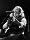 Musician David Crosby Playing Guitar on Stageat at a 32-Act Country-Rock Concert in the Silverdome