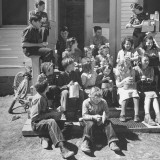 Children and Teacher Sitting Outside One-Room Country School